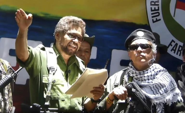 Former senior FARC commander Ivan Marquez (left) and rebel colleague Jesus Santrich, pictured at an undisclosed location in a TV grab taken from YouTube on August 29, 2019, announce that they are taking up arms again (AFP Photo/HO)