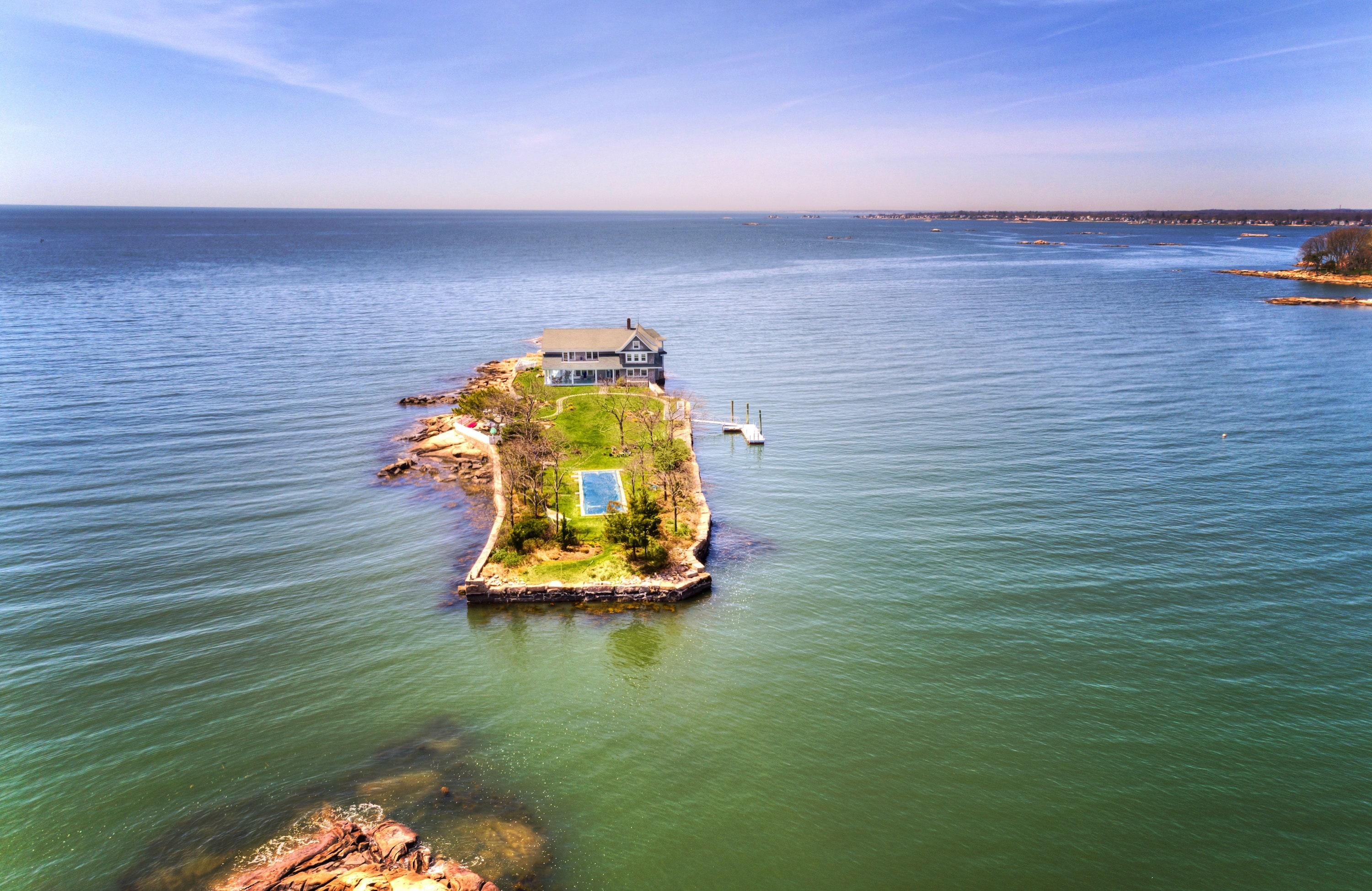 """<a href=""""https://www.christiesrealestate.com/sales/detail/170-l-78183-1805101311556549/0-potato-island-branford-ct-06405"""" rel=""""nofollow noopener"""" target=""""_blank"""" data-ylk=""""slk:Location: Potato Island, Branford, Connecticut"""" class=""""link rapid-noclick-resp"""">Location: Potato Island, Branford, Connecticut</a><br> Price: $4,900,000<br> Bed/Baths: 4 bedrooms; 3 full and 1 partial bathrooms<br> Interior Square Footage: 3,871<br> Lot Size: 1.1 acres"""