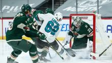 Wild lose goalie but earn victory over Sharks