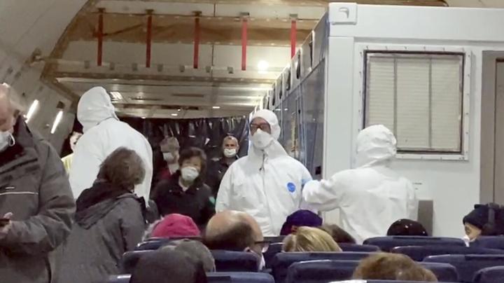 Trading quarantines, cruise passengers land in U.S.