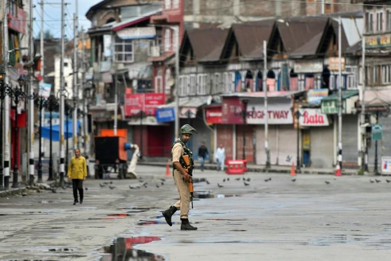 Multiple hospital sources say at least 100 people have been hurt as a result of the violence in the state of Jammu & Kashmir (AFP Photo/PUNIT PARANJPE)