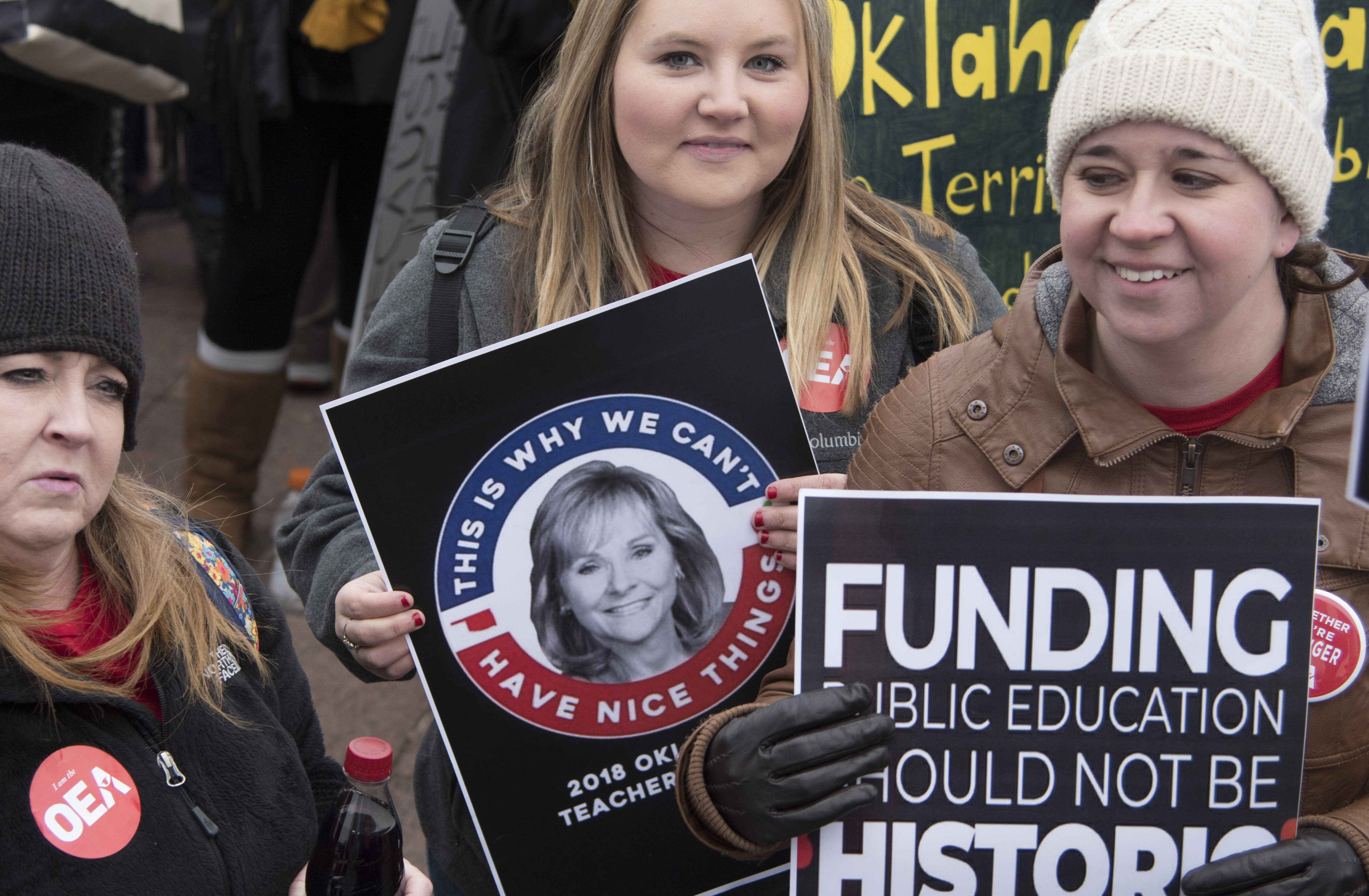 <p>Teacher Emily Mercer of Moore, Okla., holds a protest sign at the state Capitol on April 2, 2018, in Oklahoma City. (Photo: J Pat Carter/Getty Images) </p>