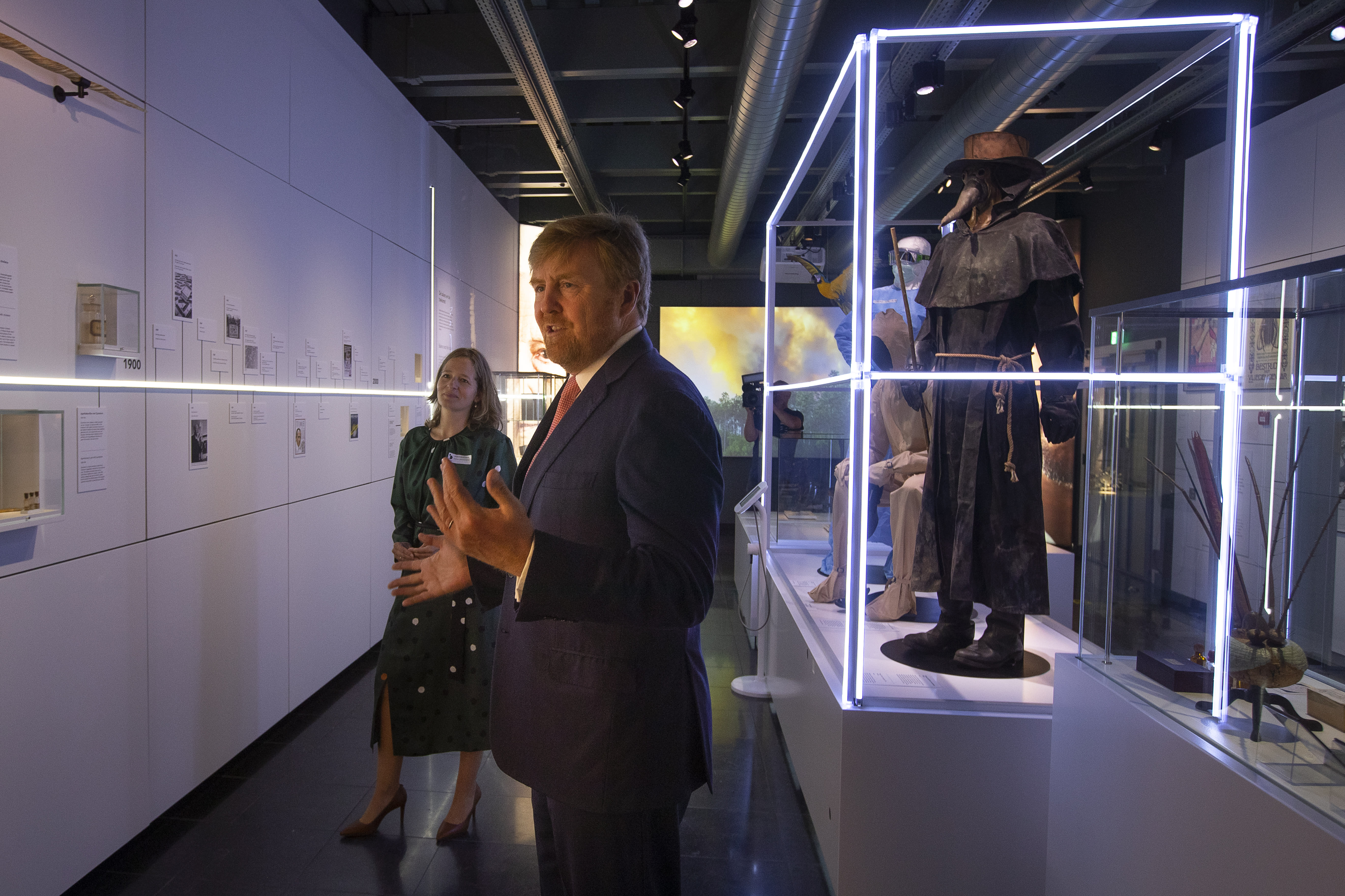 """Dutch King Willem-Alexander and curator Mieneke te Hennepe, left, tour the """"Contagious!"""" exhibit at Rijksmuseum Boerhave in Leiden, Netherlands, Thursday, July 16, 2020. The museum finally opened an exhibition Thursday on contagious diseases through the ages after a long delay caused by the disease currently sweeping the world, COVID-19. (AP Photo/Peter Dejong, Pool)"""
