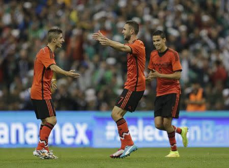 Mexico's Layun celebrates after scoring against Israel during their international friendly soccer match in Mexico City