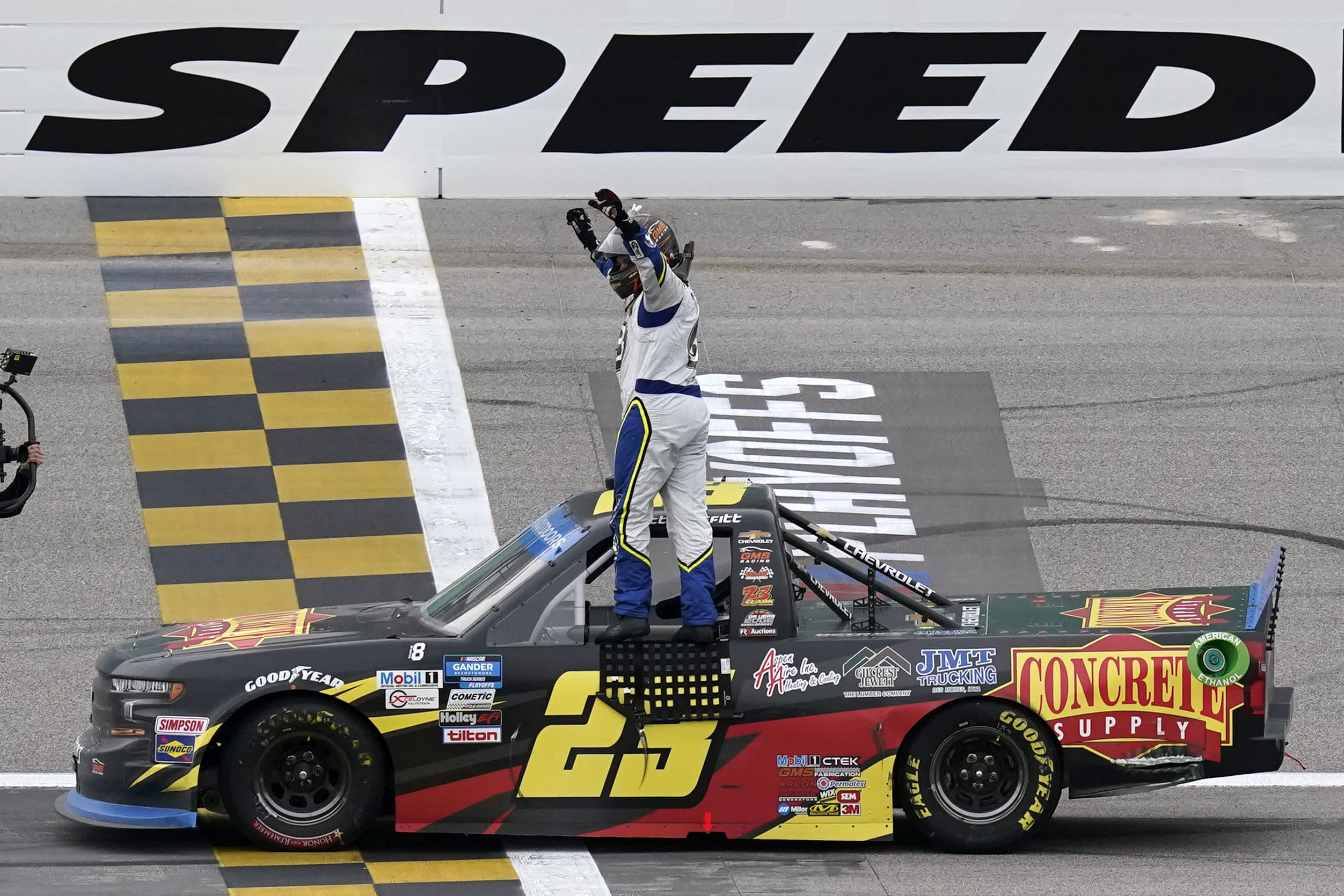Brett Moffitt (23) celebrates after winning a NASCAR Truck Series auto race at Kansas Speedway in Kansas City, Kan., Saturday, Oct. 17, 2020. (AP Photo/Orlin Wagner)