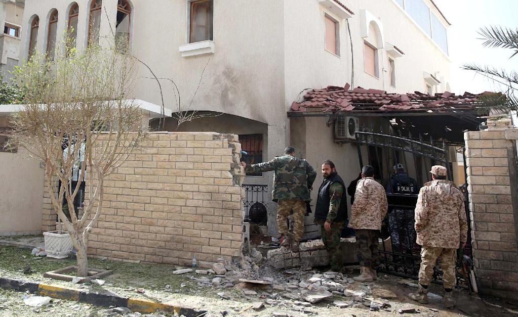 Libyan security forces inspect the site of a bomb explosion at the entrance of the residence of the Iranian ambassador in the capital Tripoli on February 22, 2015