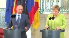Merkel, Putin tackle tough topics in meeting outside Berlin