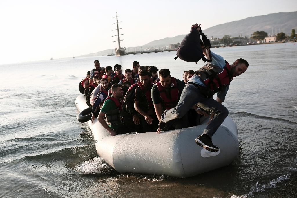 Migrants arrive on the Greek island of Kos after crossing the Aegean sea between Turkey and Greece on August 14, 2015