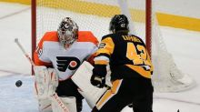 Pens beat Flyers 5-2 in front of fans for 1st time in a year