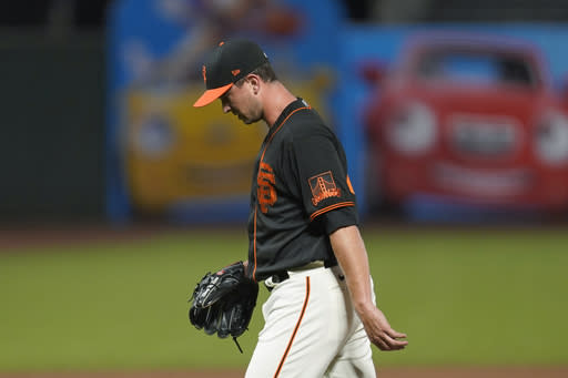 San Francisco Giants relief pitcher Tony Watson walks to the dugout after being removed during the ninth inning of the team's baseball game against the San Diego Padres on Saturday, Sept. 26, 2020, in San Francisco. The Padres won 6-2. (AP Photo/Eric Risberg)