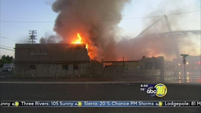 Crews fight blaze at Fresno furniture store that had its roof collapse