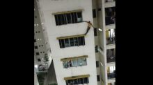 Foreign worker apprehended after standing on 7th-floor window ledge of dormitory