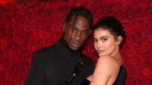 Kylie Jenner and Travis Scott share a deep kiss at his album release party