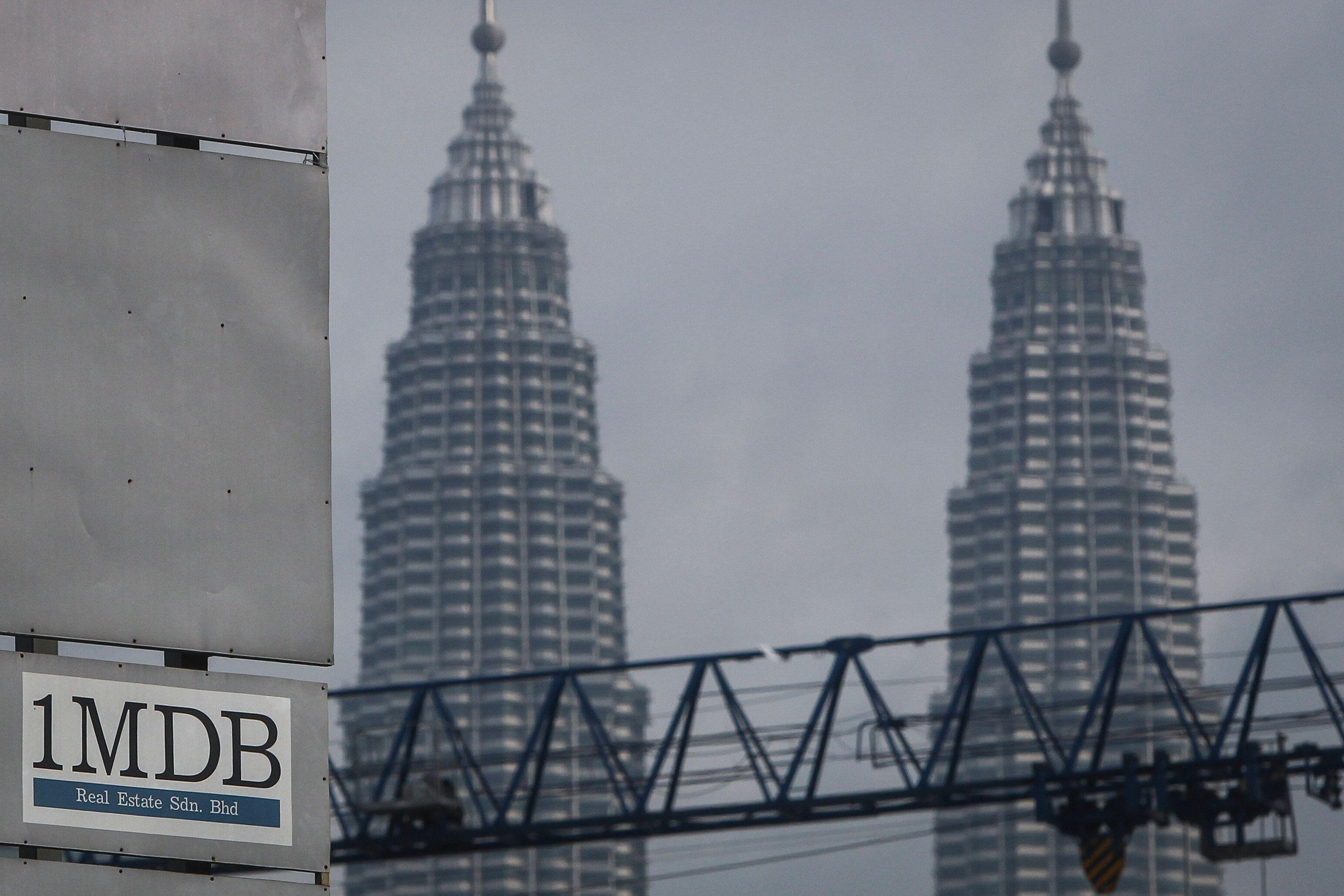 Singapore to send 1MDB money from ex-Goldman banker back to Malaysia