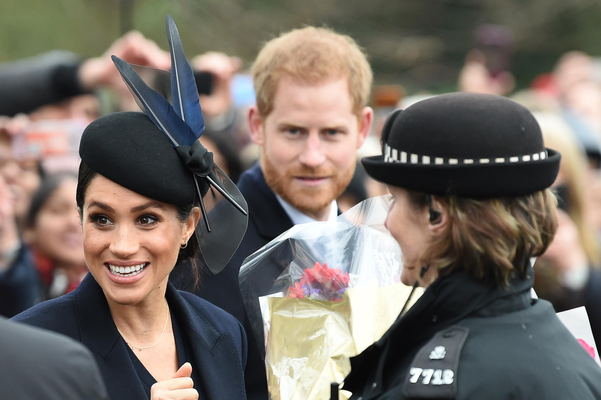 Meghan, Duchess of Sussex and Britain's Prince Harry, Duke of Sussex,   depart after the Royal Family's traditional Christmas Day service at St Mary Magdalene Church in Sandringham, Norfolk, eastern England, on December 25, 2018. (Photo by Paul ELLIS / AFP)        (Photo credit should read PAUL ELLIS/AFP/Getty Images)