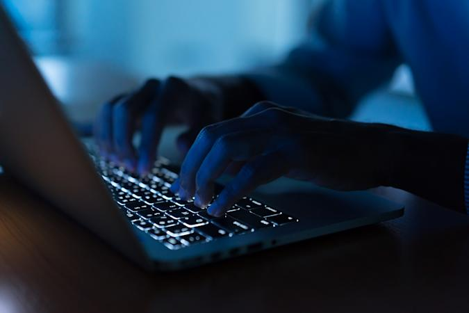 close up programmer man hand typing on keyboard laptop for register data system or access password at dark operation room , cyber security concept
