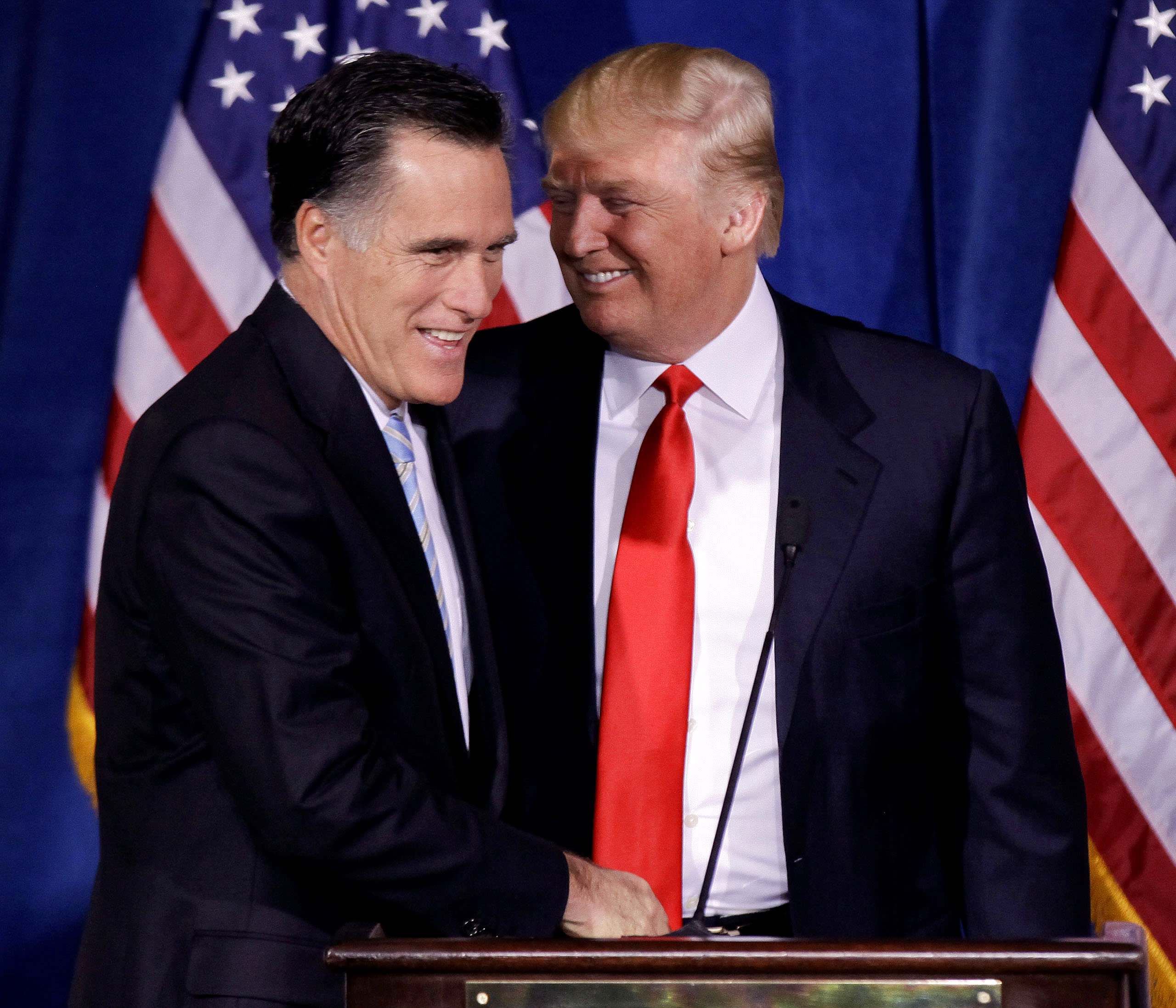 FILE - In this Feb. 2, 2012 file photo, Donald Trump greets Republican presidential candidate, former Massachusetts Gov. Mitt Romney during a news conference in Las Vegas. Romney is set to clinch the Republican nomination for president Tuesday with a win in the Texas primary, a feat of endurance for a candidate who came up short four years ago and watched this year as voters flirted with a carousel of front-runners before eventually warming to him. (AP Photo/Julie Jacobson, File)