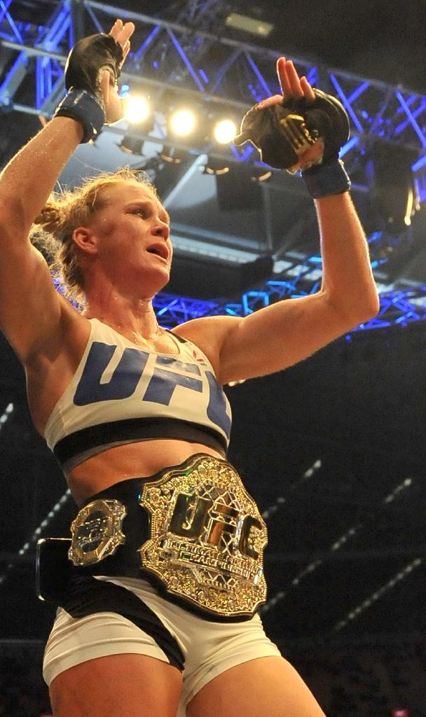 Holly Holm celebrates after winning the UFC title fight against Ronda Rousey in Melbourne on November 15, 2015 (AFP Photo/Paul Crock)