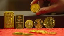 Gold futures settle at a roughly 2-week high