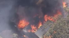 Chilling warning as out-of-control bushfire 'destroys 30 homes'