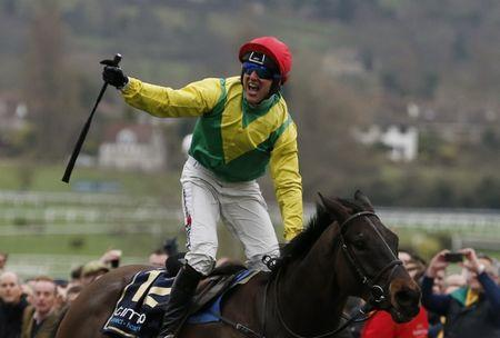 Robbie Power celebrates winning the 3.30 Timico Cheltenham Gold Cup Chase on Sizing John