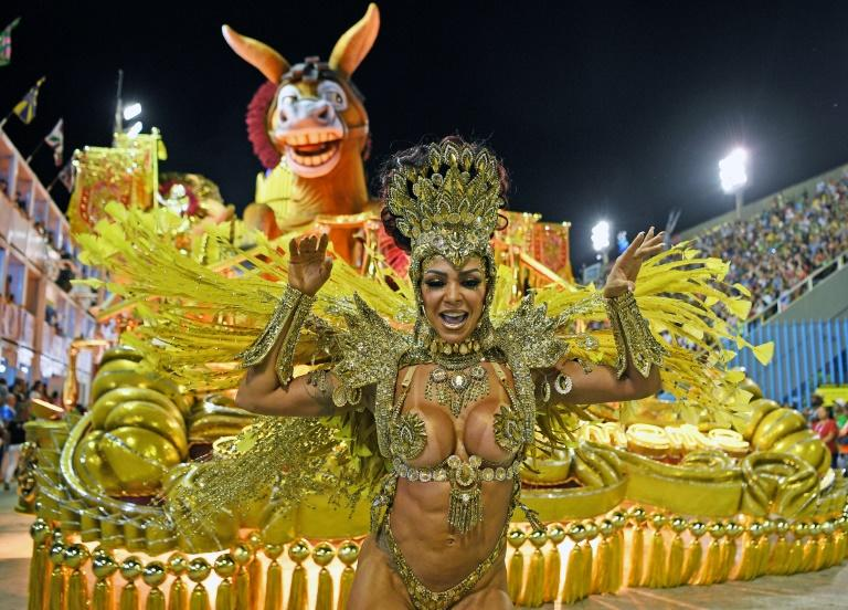 The sumptuous parades and monumental floats attract tens of thousands of tourists to Rio for the carnival every February