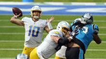 Justin Herbert flashes promise but struggles with turnovers in Chargers' loss