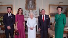 The Queen sparks health concerns after being photographed with a 'purple hand'
