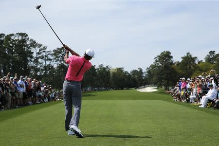 Tiger Woods of the U.S. hits a driver off the first tee during practice for  the fc2fb3659