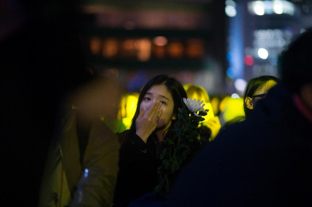 A mourner weeps during a rally marking the first anniversary of the Sewol ferry disaster, in Seoul on April 16, 2015 (AFP Photo/Ed Jones)