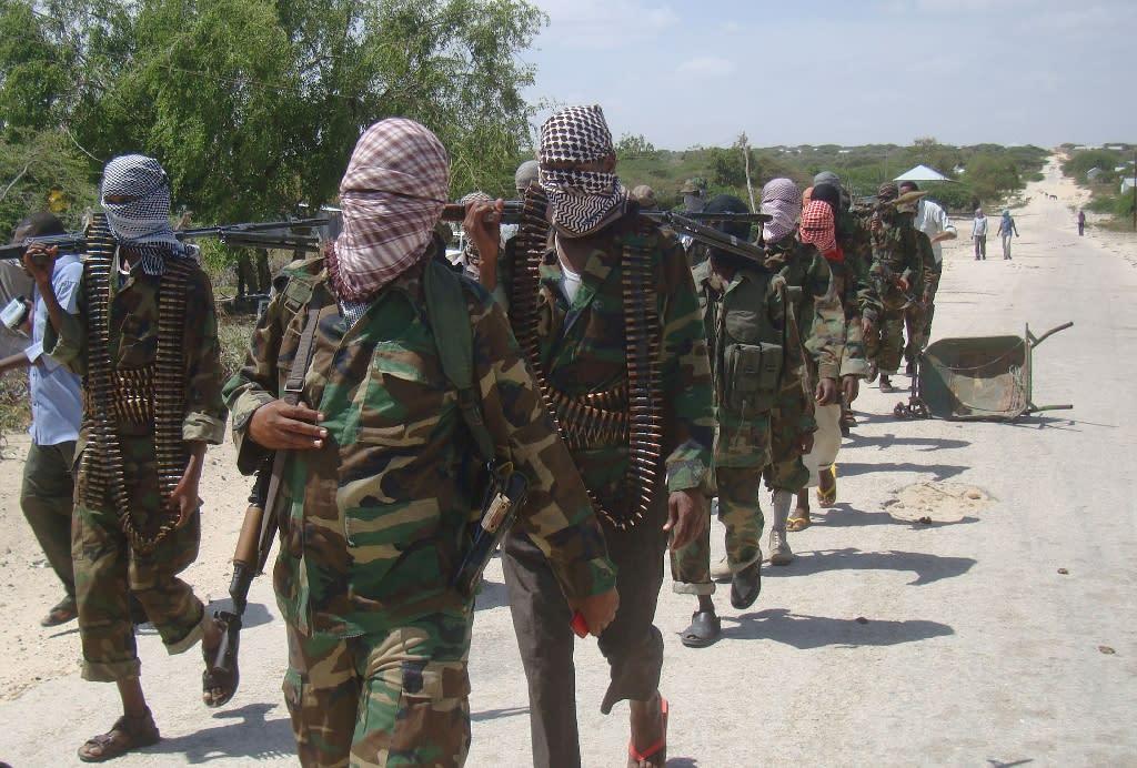 Al-Qaeda linked al-Shebab recruits walk down a street in the Deniile district of the Somali capital Mogadishu on March 5, 2012 (AFP Photo/Mohamed Abdiwahab)