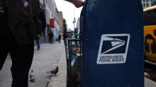A USPS worker suspected of throwing away bags full of mail posted about the QAnon conspiracy theory