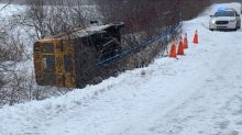 School bus tips over on icy road in Inverness County