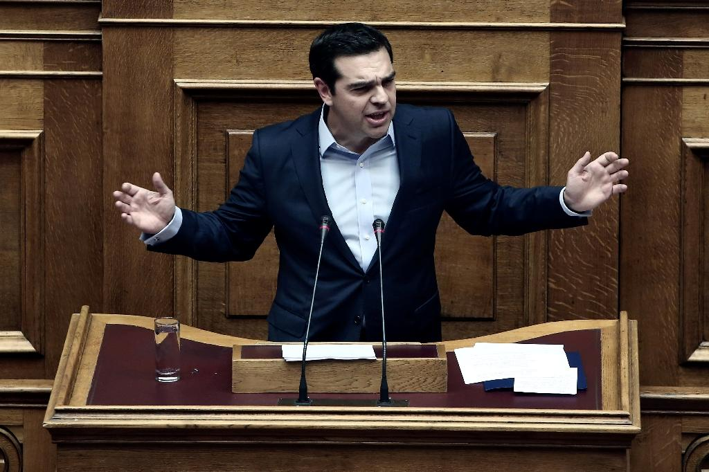 Alexis Tsipras has announced measures to help pensioners and the Greek islands that have been on the frontline of Europe's migrant influx (AFP Photo/Angelos Tzortzinis)