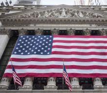 Investors sticking with stocks despite volatility