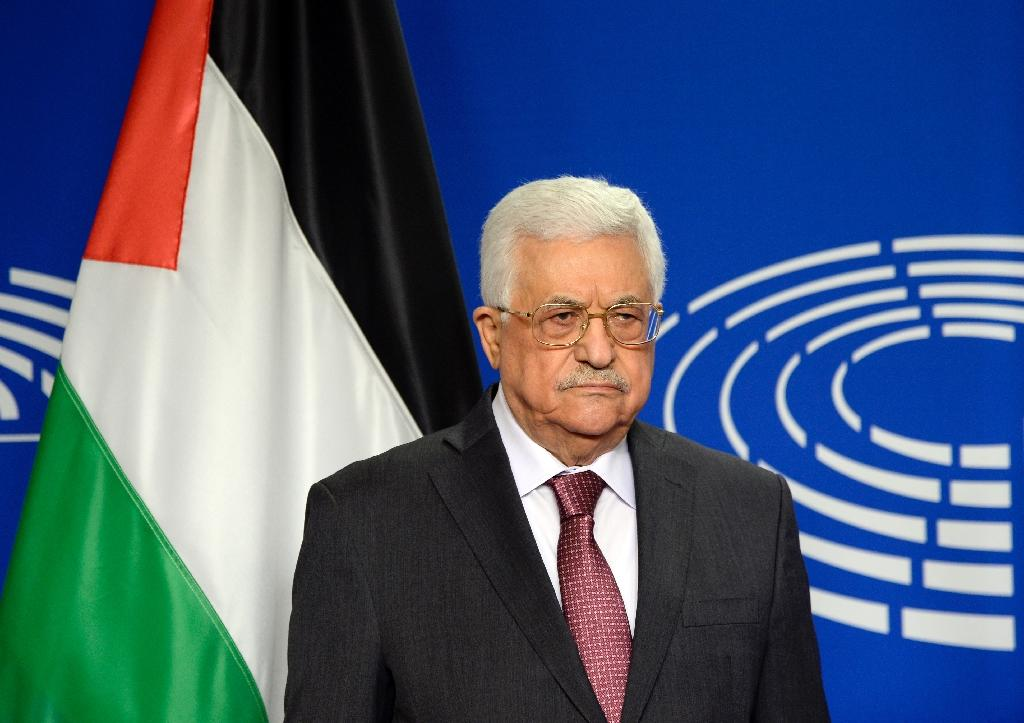 Palestinian President Mahmud Abbas poses for photographs at the European Parliament in Brussels on June 23, 2016