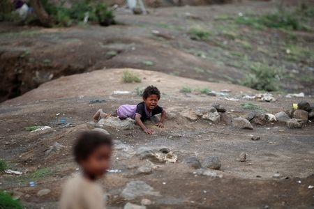 Boy cries at a camp for internally displaced people near Sanaa, Yemen