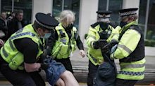 Police launch urgent review after woman's underwear exposed during protest arrest