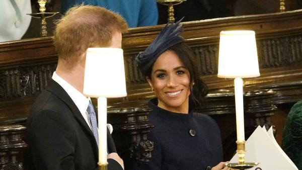 1f74ff034fb Meghan Markle wears navy Givenchy to Princess Eugenie s royal wedding