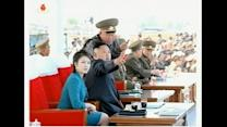 North Korean leader and his wife watch combat flight contest
