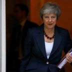 British PM hails Brexit deal but must sell it to doubtful ministers