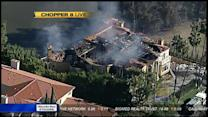 Mansion goes up in flames in gated community