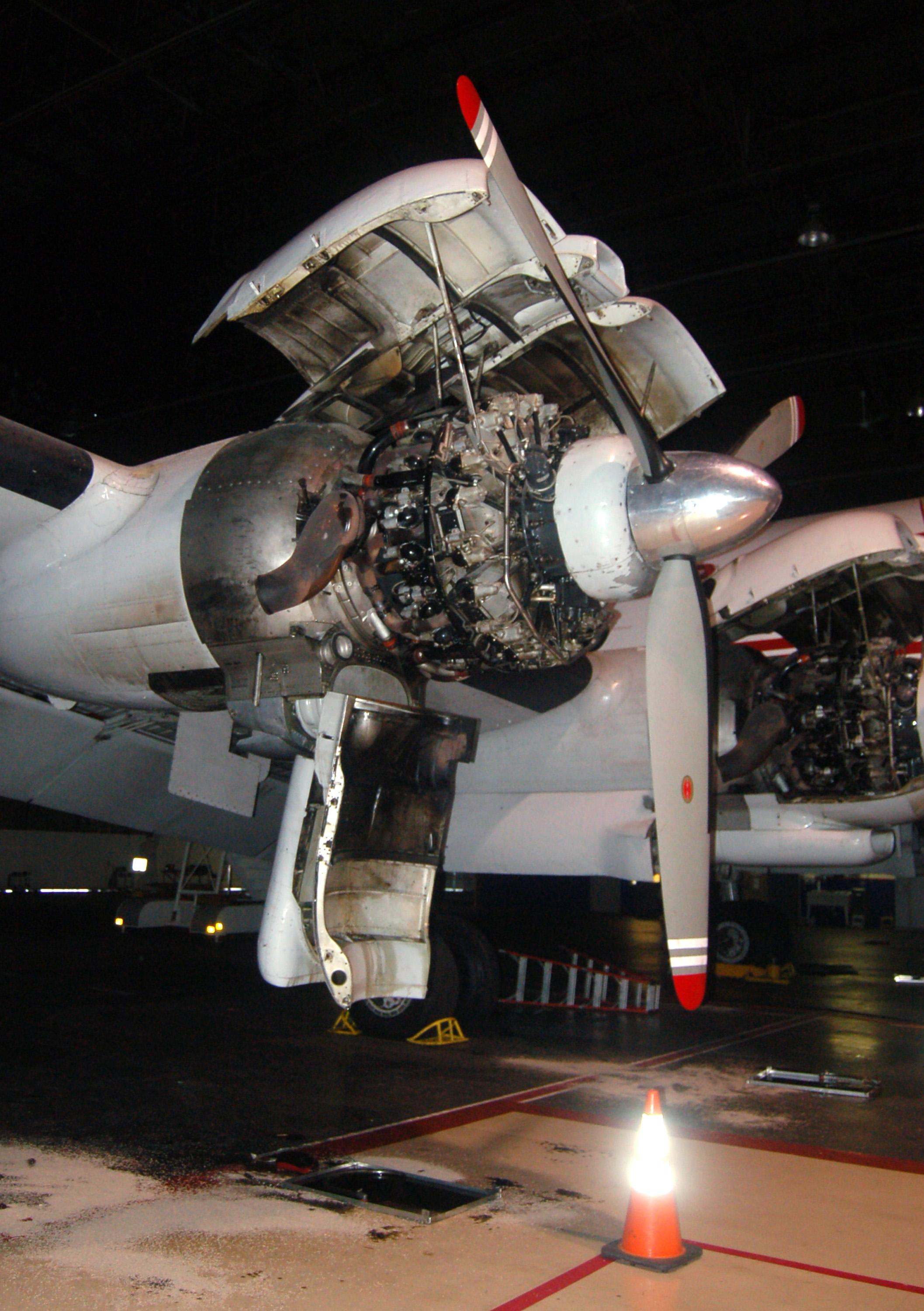This 2012 photo provided by the National Airline History Museum shows its Lockheed Constellation, or Connie, as the propeller-driven aircraft was known, during engine inspection in Kansas City, Mo. The museum is trying to raise $3.2 million to restore it, the only one left in the U.S. that's airworthy, and recreate millionaire aviator Howard Hughes' record-setting cross-country flight in the plane that transformed commercial air travel. (AP Photo/National Airline History Museum)