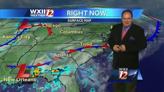 Warm with few clouds and isolated showers in the Piedmont