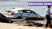 BREAKING: Car drives off cliff, hitting mum and daughter on beach below