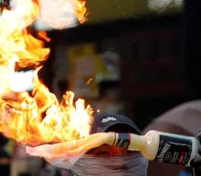 Petrol bombs thrown in Hong Kong as anger flares over 'triad' attack on protest leader