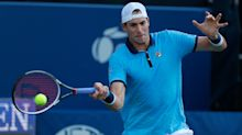 Isner eases into last eight in Atlanta