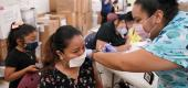 A nurse administers a COVID-19 vaccine to a patient. (Lynne Sladky/AP)