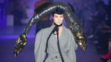 Model walks Vivienne Westwood catwalk in a giant fish hat at Paris Fashion Week
