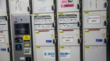 Japan woman held over keeping baby body in locker 'for years'